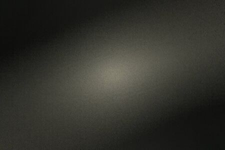 Black rough metal wall with light shining through in dark room, abstract background Stock fotó