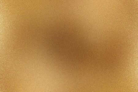 Brushed light brown metallic wall with scratched surface, abstract texture background