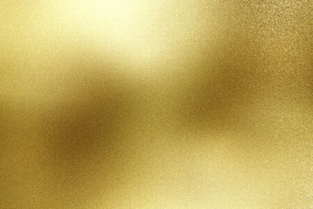 Brushed gold hard metal wall with scratched surface, abstract texture background