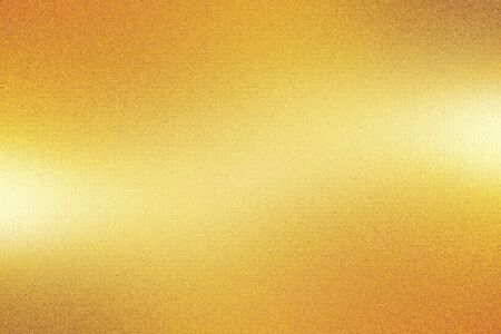 Orange foil metal wall with glowing shiny light, abstract texture background Banco de Imagens