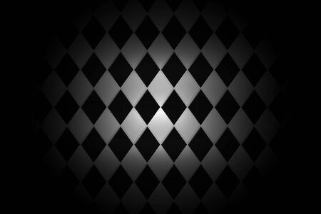 Light shining down on black white rhombus ceramic tile wall in dark room with copy space, abstract background