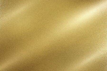 Light shining down on gold foil metal wall with copy space, wallpaper background Фото со стока