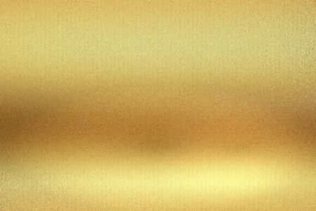 Glowing gold foil metal wall background with copy space