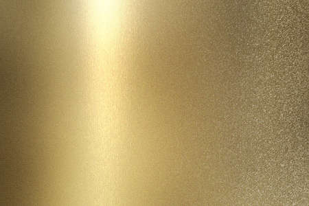 Glowing gold foil glitter metallic wall with copy space, abstract texture background