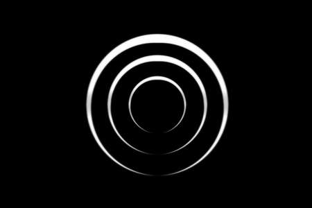 White spiral with circle ring on black backdrop, abstract background 版權商用圖片