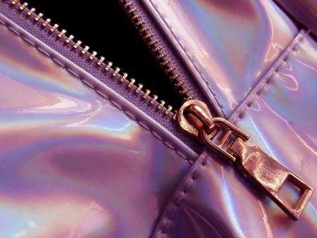 pink toned bag fragment with metal zipper close up Stock Photo
