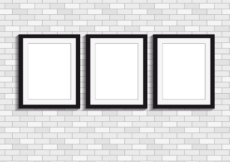 Vector illustration of three picture frames on a white brick wall background in black and white Illustration