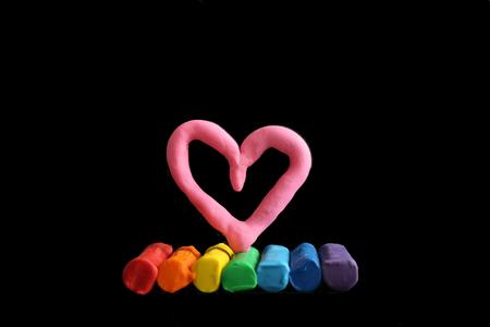 Gay friendly concept rainbow colours plasticine heart