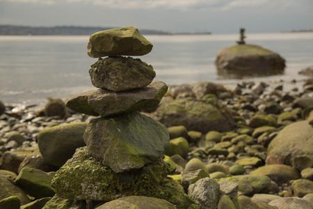 massage symbol: Concept simplicity pile pebbles rocky beach