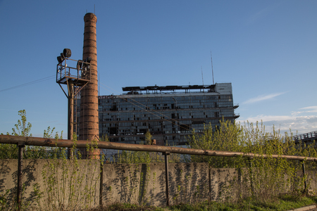 Destroyed industrial site outside pipes Stock Photo