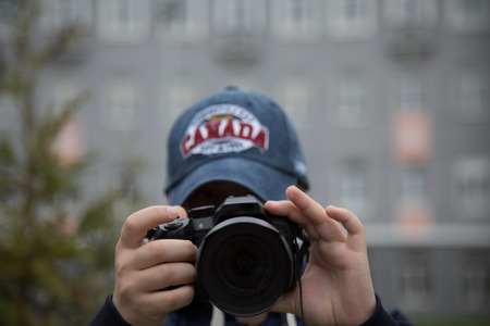 shutter: Camera lense directed on viewer concept photography
