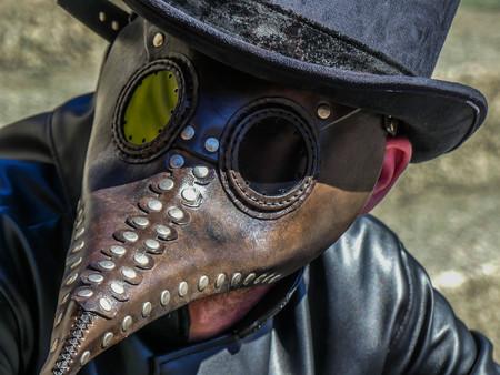 Close up leather man fantasy costume bird beak Banque d'images