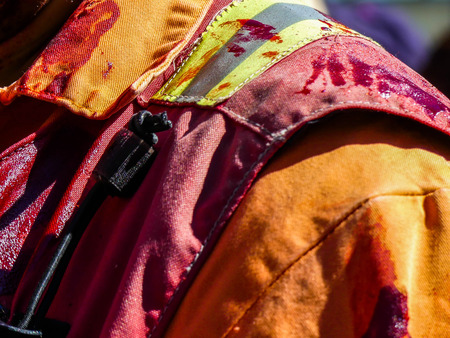 Fake blood stains orange uniform fireman concept danger