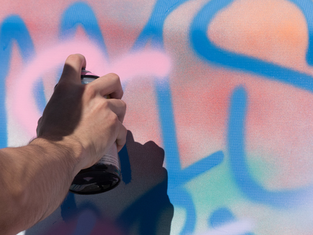 Young male hand background graffiti close up