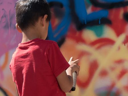 Street art graffiti child creating murals concept creativity