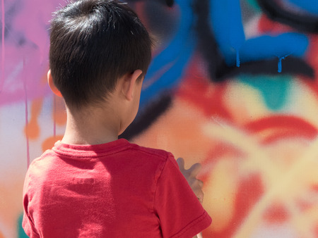 Street art graffiti child creating murals art education