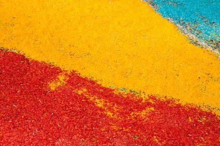 Art raw rice grains asphalt red yellow blue stripes concept creativity
