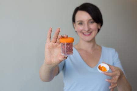 Female doctor portrait hands holding pills copy space Stock Photo - 122844158