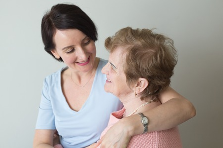 Adult daughter hugging elderly mother concept connection Stock Photo