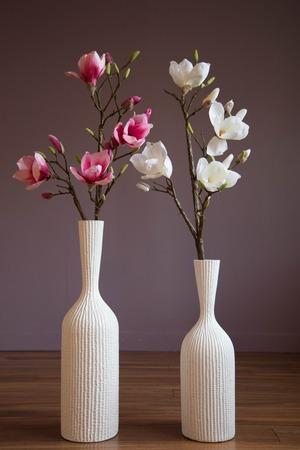 Style interior design vases magnolia branches pink white flowers Stok Fotoğraf