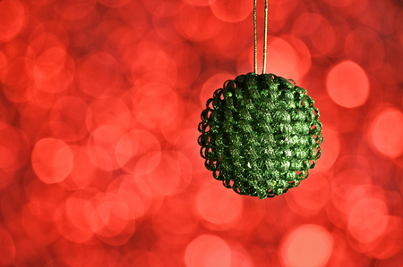 Elegant colored New Year and Christmas ball on the background with light effect and bokeh.Green,orange Stock fotó
