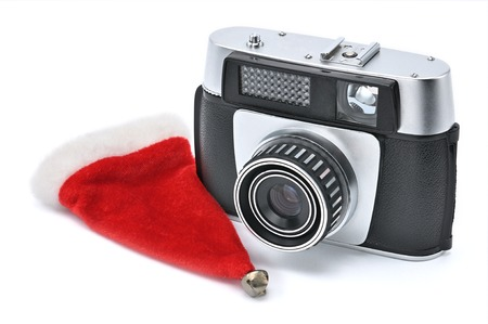 Santa Claus Little Red Riding Hood and vintage camera for photographing on a white isolated background