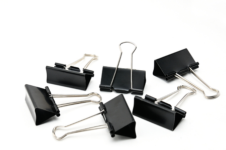 Binder clip device for tying paper sheets together Stock Photo