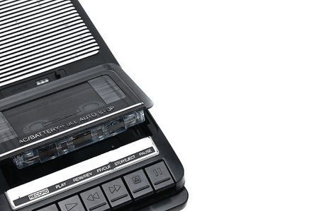 Cassette tape recorder for recording and playing audio cassettes on an white isolated background.Vintage