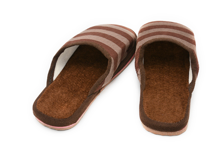 Slippers used at home on a white isolated background.Sneakers