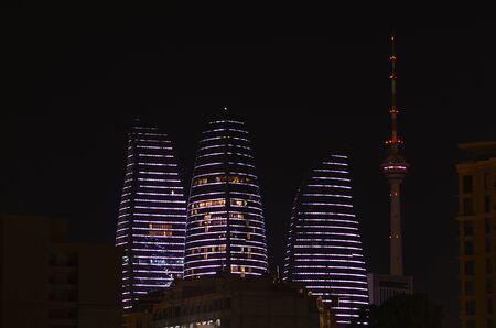 12-05-2019.Baku.Azerbaijan.Views of night city and lighting effects Baku. Flame Tower, TV tower and other facilities. Stok Fotoğraf