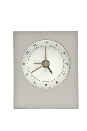 Silver metal clock on an isolated white background.Watch.