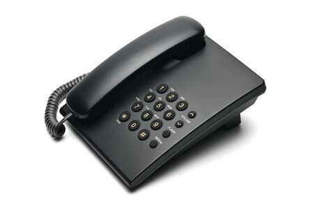 Classic wired telephone used at home and in offices on a white isolated background.