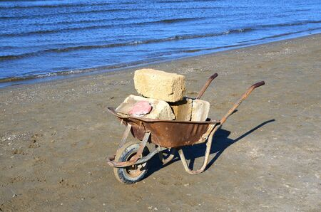 Wheelbarrow for housekeeping and construction work,on site.Cart.Trolley with one wheel