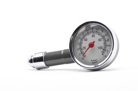 Pressure gauge for measuring air pressure in automobile tires close-up on an isolated white background Archivio Fotografico
