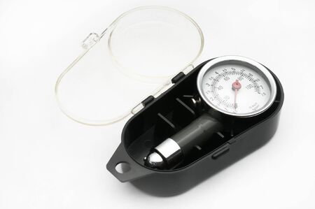 Pressure gauge for measuring air pressure in automobile tires close-up on an isolated white background