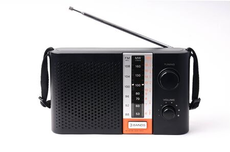 Vintage radio for listening to radio programs on an isolated white background