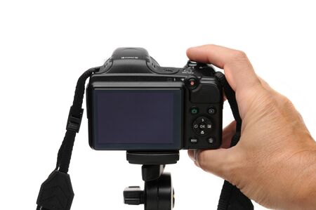 Digital photo camera on an isolated white background