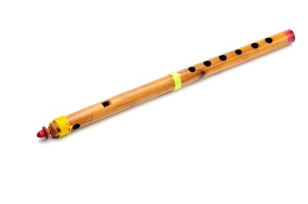 Bamboo wind instrument indian flute on isolated white background