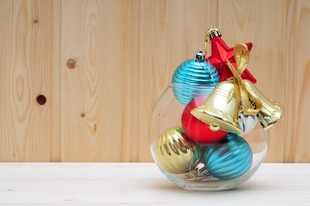 Christmas and New Years toys and a glass aquarium on a wooden background
