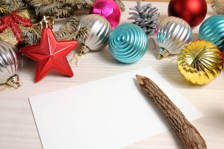 Christmas white wooden patterned background with Christmas tree branches and toys