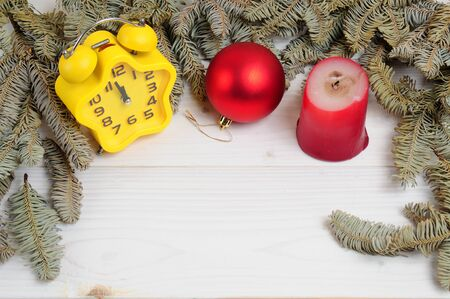 Christmas white wooden patterned background with Christmas tree branches,toys,clock and white paper Stok Fotoğraf