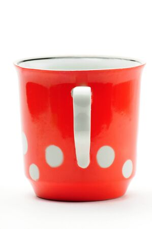Vintage red cup with white peas on an isolated white background