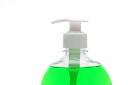 Bottle of green liquid soap on isolated white background