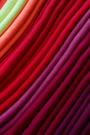 Folded fabrics with rich, warm rainbow colors photo