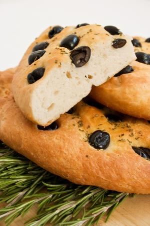 talian: talian focaccia bread over sprigs of fresh rosemary