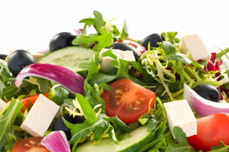 Detail shot of greek salad on a whte plate Stock Photo