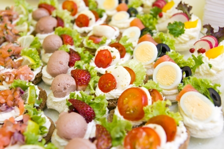 finger food: Mixed mini canapes on a plate
