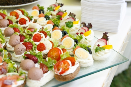 Mixed mini canapes on a plate photo