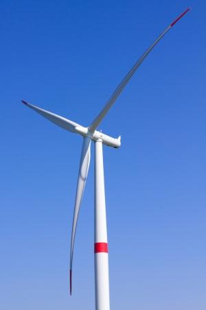 Modern wind turbine with blue sky photo