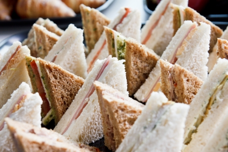 ham sandwich: Cut platter of mixed  sandwich triangles